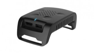 The tranmission module of the TPCAST accessory seen sporting HDMI and USB ports