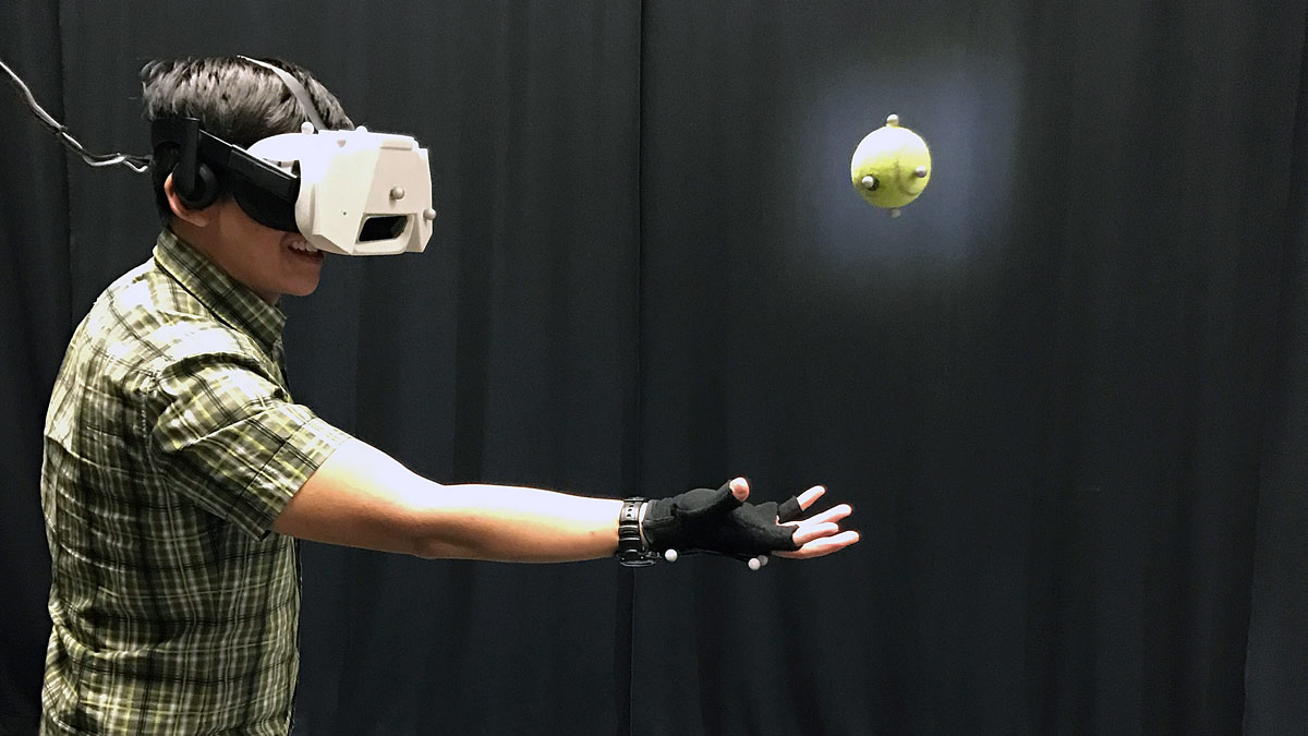 Real ball caught in a virtual environment