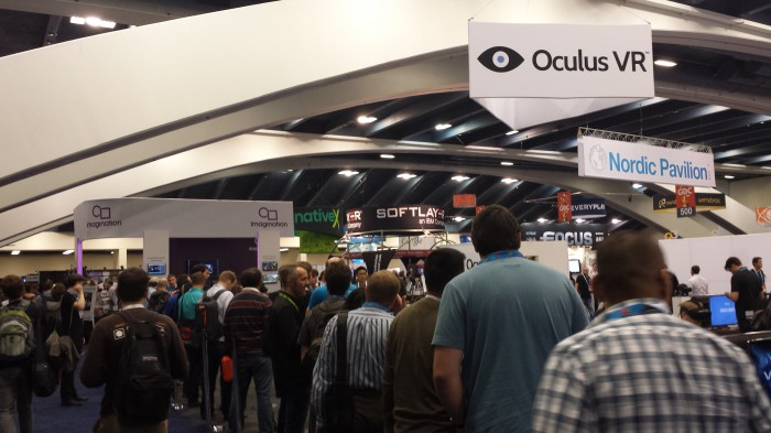 The Oculus booth is teeming with activity.